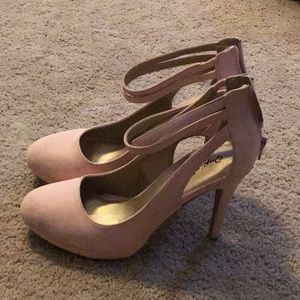 Pair of pale pink high heel shoes